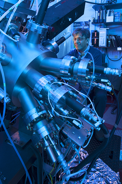 Working with the molecular beam epitaxy equipment in his lab.